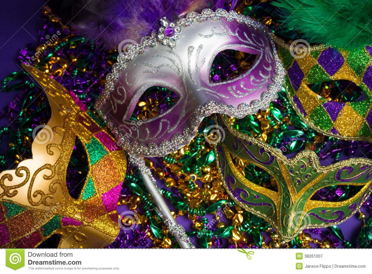 assorted mardi gras or carnivale mask on a purple background stock