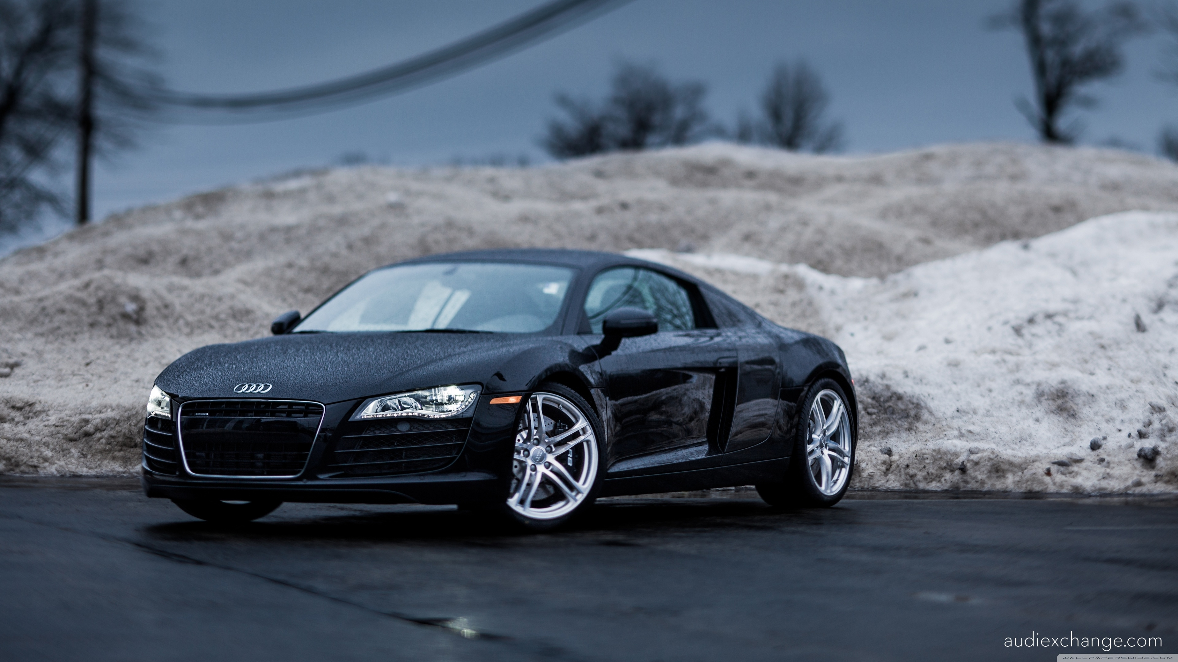 black audi r8 4.2 v8 coupe, photographed with a tilt-shift lens