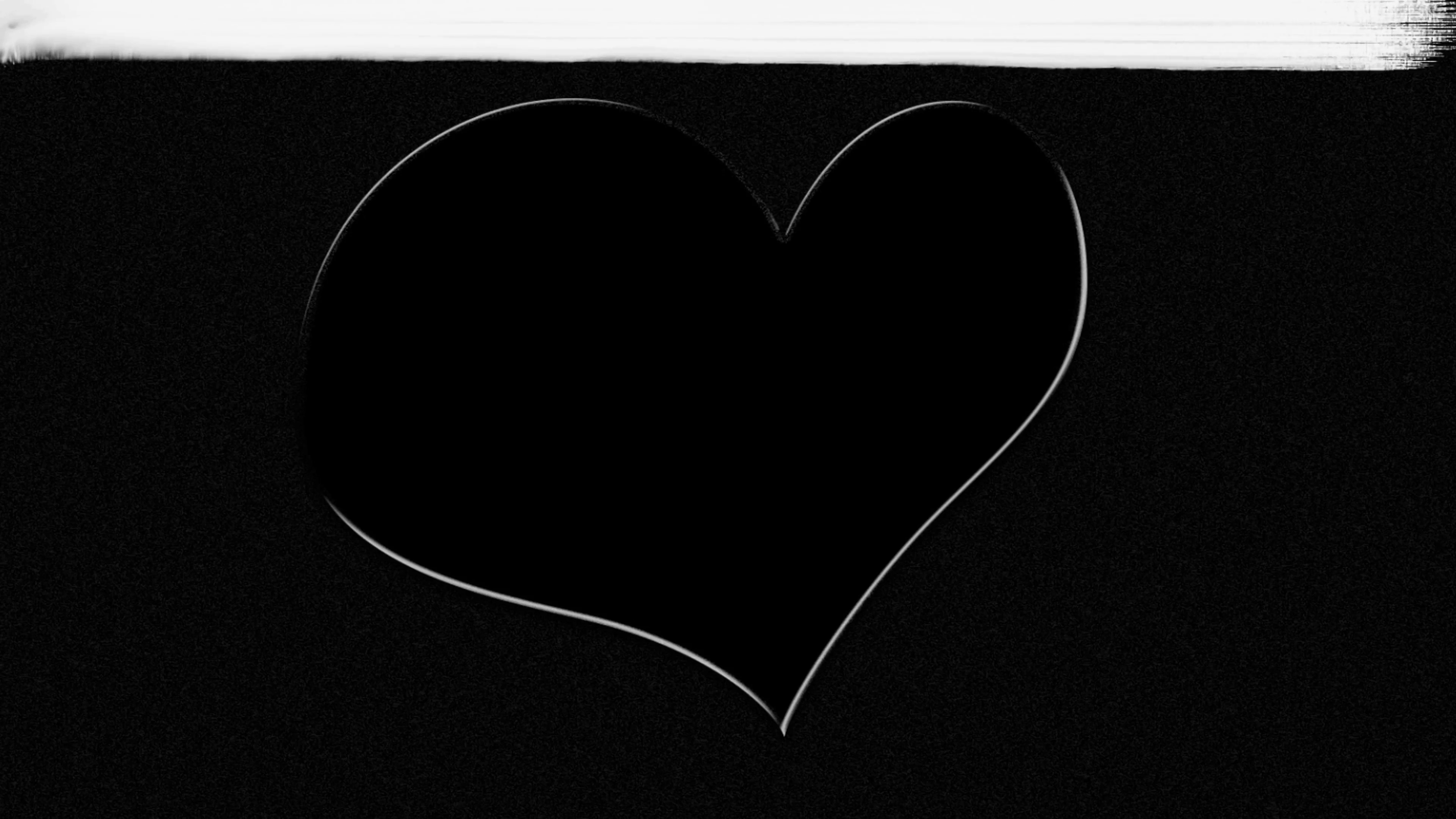 hand drawn white heart on black background painted over with white