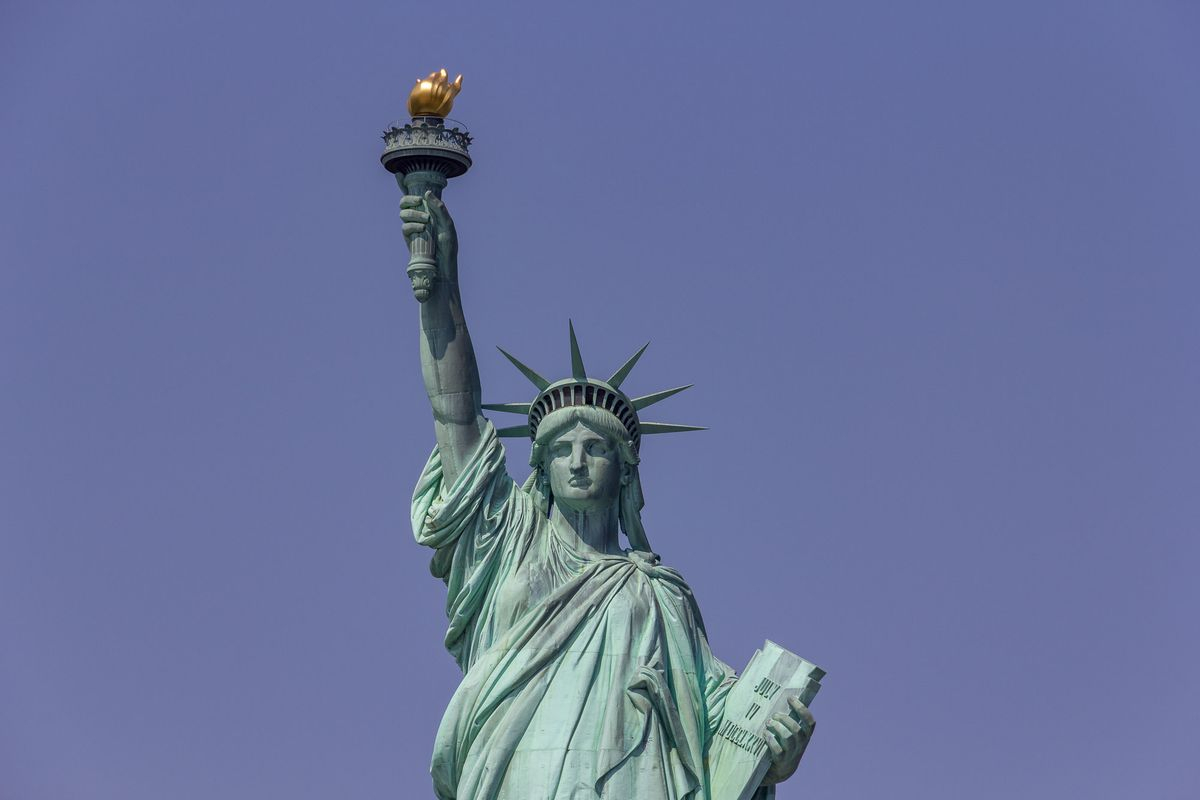 statue of liberty's original torch relocated to its new home - curbed ny