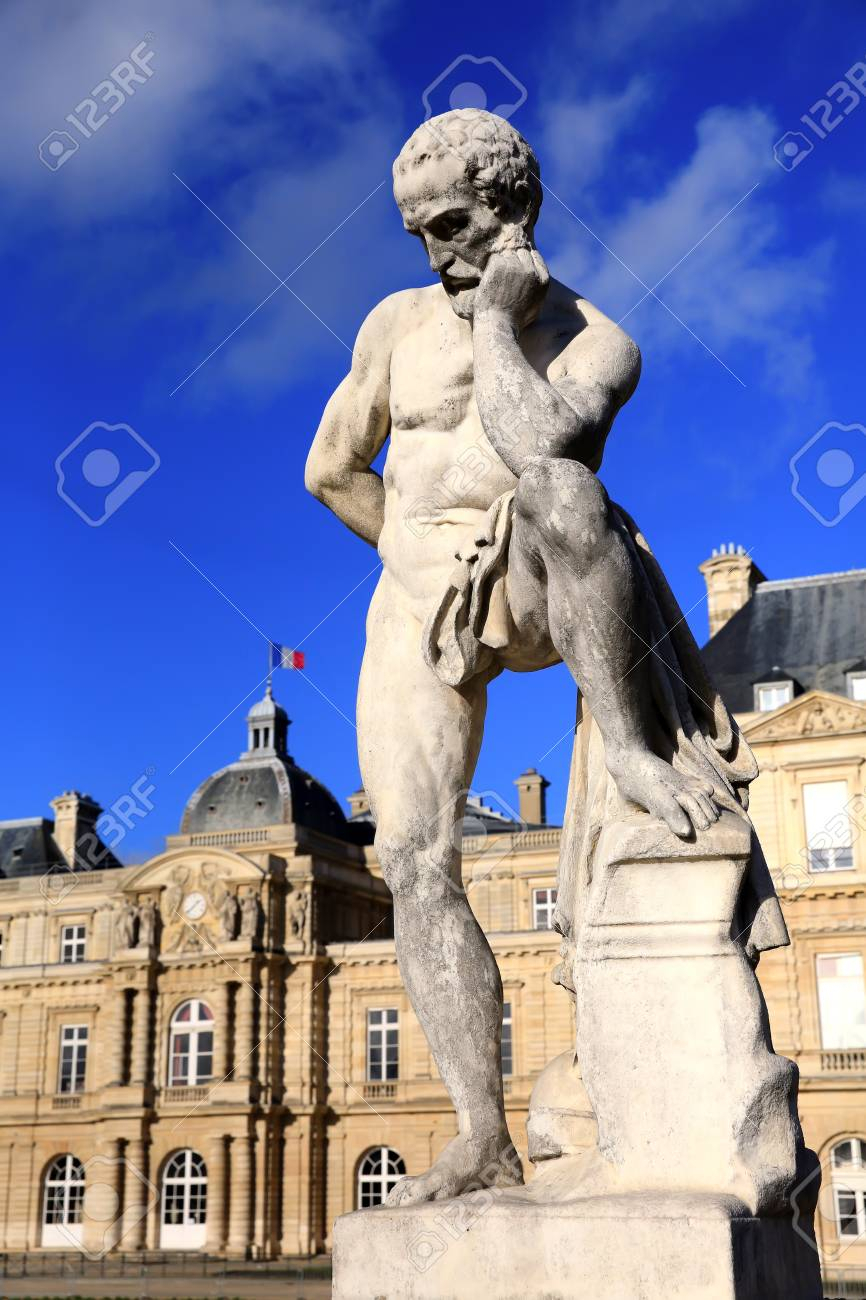statue of the thinker man in front of the french senate at the